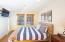 Main level bedroom has morning sun and a full bath