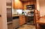 Kitchen w/ stainless steel appliances including sub zero refrigerator