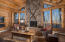 Vaulted great room with wood-burning fireplace and western views