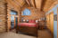 Upper level master with king bed, bath ensuite and vaulted ceilings