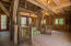 The reclaimed timber-frame Horse Barn's focal point is a late 1800s hand-powered freight elevator recycled from a building in Telluride.