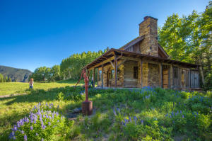 Sitting on the porch of the Writer's Cabin, the ski area, the historic Alta townsite, miles of trails and several turquoise alpine lakes dot the landscape beyond.