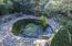 Looking down @ fire pit, pond area from hot tub deck above.