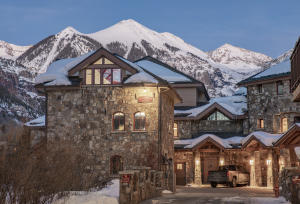 Rivercrown 1 is situated in a private building along Telluride's river trail with unobstructed views of Ajax Peak.
