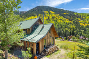 This amazing local home is on an oversized lot and is adjacent to public land.