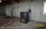 Pellet Stove and Stubbed Bath in Basement.