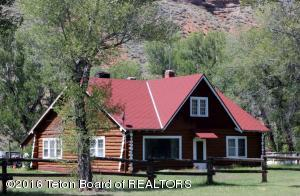 20.20 Acre property with 4 BR/2 BA authentic log home and a point of access on the Wind River.