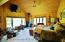 Master Bedroom with Full Bathroom. Views of the wild rose gardens and aspen grove lawns.