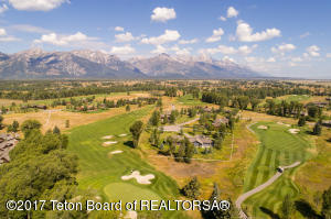 Aerial view with the Grand Teton in the background and the 5th & 6th fairways wrapping the property boundary.