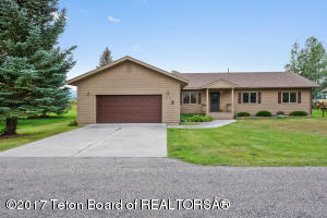 Welcome to 3075 Bridle Drive in the coveted NW corner of Rafter J.