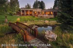 A sanctuary with sweeping Teton views from the floor to ceiling windows.