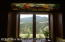 Kitchen view of Wind River Range accented with custom stained glass