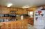 Well Designed Kitchen Area With Plentiful Cabnitrey