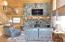 Living Area / Huge Stone Fireplace Facing / Hickory Floors