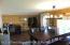Opposite View of Dining Area Looking Toward Front Door. Small Office Area In Corner.