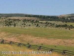 240 acres of fields and wildlife habitat.