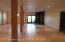 Basement activity area. Has a wood stove, walk out french doors to a cozy, protected patio area. 10 ft ceilings, windows and in-floor heat make this a super comfortable extra living area.