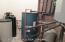Utility room. Water softener, hydronic floor heat, central vac and pressure tank; all located in one large, accessible location.