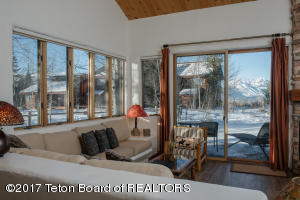 Step-down living room offers lots of comfortable seating and Teton views