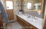 downstairs full bath has newer countertops and tub/shower surround