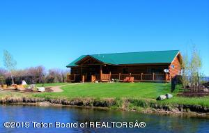 Log Home on the River