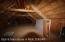 Through the loft door is the barn loft and hay storage, complete with a traditional hay loft door.