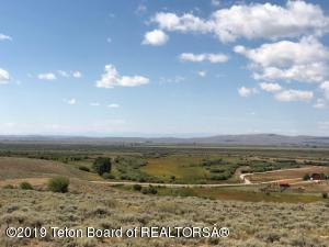 Looking To The SW From The East Side Of The Property (High Side). Wyoming Range Mountains In The Background. Lush Grass In The Bottom.