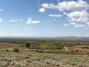 Looking To The SW From The East Side Of The Property (High Side). Wyoming Range Mountains In The Background. Lush Green Grass In The Bottom.