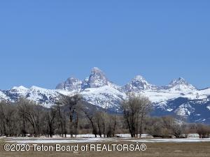 Spring Creek runs for a mile through this 200-acre parcel with panoramic views of the Teton Range. Excellent opportunity for a private fishery with Spring Creek spilling into the Teton River just downstream.
