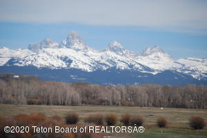 158 spacious acres with wide open views of the Grand Teton Peaks and mountain range. Perfect for a private home and the grazing of cattle or horses. Complete with Water Rights. Frontage on Badger Creek which flows seasonally. A spring creek runs through the property.
