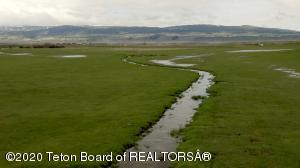 View Property Video. Take in the breathtaking views of Teton Valley as you drop down from Harrop's Hill and cross the world-famous Teton River, shortly after to be welcomed by the vast pastures of the Bahr Ranch . For many generations, the Bahr Ranch has been a landmark on the North End of the Valley.Homesteaded in the late 1800s, it's easy to imagine life back then. You can catch a glimpse into the past when stepping onto the bluff overlooking the 290+ acre ranch. With a home, shop, outbuildings, working pens, and water rights, this offering is truly the ideal setup. In the spring you'll find natural groundwater meandering its way through the lush green pastures.  Paved road frontage on two sides of the property means year-round easy access.And of course, with breathtaking Tet  views it becomes easy to understand why the Bahr family made this land their home.   The Teton River is just down the road for short travel to catch a cutthroat trout or wade in the cool waters after an honest day's work on the ranch. Equally close is the city of Tetonia where kids can play in the park, attend school, and friends can catch up on the valley talk at the gas station or the weekly summer rodeos.  This property that has raised many families is now being offered to another, to pass the torch of making cherished childhood memories and fulfilled dreams.