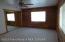 master bedroom with mirrored closet doors
