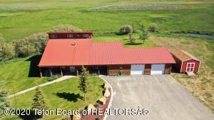 Incredible opportunity to own a piece of history. This property has a great horse set up with quality barns, pipe corrals and shop buildings Muddy creek runs through the property. It has native grass hay meadows and some range pasture lands as well. The home has three bedrooms and two baths. Open floor plan with a large master suite. Beautifully landscaped and it has a garden and green house. It is a hidden gem  with great mountain views . Private but very accessible to  main access roads.