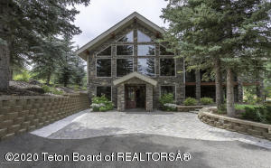 Newly remodeled home in 2016. Incredible views of the valley from Willow Creek area. Fully landscaped yard with many mature trees. The  lower level of the house has  in-floor hydronic heat as well as the upper level kitchen floor, for warm feet while your cooking.  The kitchen has a SubZero side by side refrigerator, new unused microwave, Dishwasher and  2 ovens with side open doors for ease of loading/ unloading with a large separate warming oven, the Russel cook range has a new popup down draft vent . Two Primary master bedrooms with on suite baths. Wood burning fireplace and two Propane fireplaces for added atmosphere and functional heat.  A large three bay detached garage that can hold 6 cars and still have room for a work shop.  The garage has a 200 amp electric service for the shop. The bonus for this garage building was structurally engineered to have a home built on top of it as guest quarters this has a separate  200 amp service ready for the building and development of a family compound.  The final building is a  large horse barn next to the pasture a convenient place for the horses and livestock in a perfect family retreat.