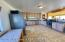 This massive kitchen has plenty of room for more than one cook in the kitchen!