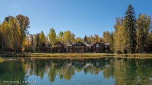 Please take our ''virtual tours'' of each home shown in the photos tab.  This extraordinary Estate is located just north of the town of Jackson, along the Gros Ventre River. The property consists of 3 parcels, for a total of 127 acres, with a private pond fed from the spring creek and the Gros Ventre River, with stunning views of the majestic Teton Range.The main home is approximately 13,300 sq. ft. has 7 bedrooms, all en-suite, 2 powder rooms & 10 wood burning fireplaces. The many gathering areas include 1 sitting room off the kitchen & 2 additional areas adjacent to the guest bedrooms on the main & second levels. The cozy library on the 2nd level is ideal for relaxing by the fireplace with a book. The sun room is the perfect spot for wildlife viewing with the awe inspiring pond and the Tetons as a backdrop.  The main home consists of amazing hand crafted log construction, oak floors, spacious office, & commercial grade kitchen, all with superb mountain views. The charming guest house contains 2 bedrooms, 2 baths plus a loft and is approximately 1,945 sq. ft. There are 2 wood burning fireplaces in the guest house.   A recreational easement exists for an additional 3 neighboring parcels which includes Elk Run Estate. Therefore the new owners will be able to enjoy the use of these additional parcels for fishing, hiking, biking, picnicking, etc. Only 2 other homeowners are granted the use of this easement.  Some of the best fly-fishing in the valley can be accessed by the owners of Elk Run, along the confluence of the Snake & Gros Ventre Rivers and a large spawning spring creek. One of the parcels of Elk Run is vacant and will allow for development rights, adhering to only Teton County regulations.    The property of Elk Run is one of the most beautiful properties that exists in the entire Rocky Mountain region of the U.S.  The 127 acres has large mature conifer and native deciduous trees, with a river from the Gros Ventre mountain range that meanders serenely through