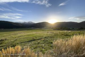A premier, 35-acre ranch estate lot at the private Snake River Sporting Club, bordering the Bridger-Teton National Forest. A 5-bedroom, 8,000sqft mountain modern home has been designed, with a possible start in the summer of 2021. Enjoy the broad vistas and easy recreational access out the back door to over 3.4 million acres of public land. A perfect blend of club amenities and wilderness in a private enclave makes for an ideal family compound. Experience horseback riding, fishing, and the wildlife that cross through the migration corridor in your front yard. The ranch estate lots offer large pastures and mountainous views in all directions.