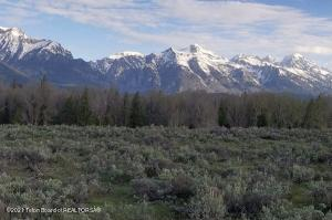 Just minutes from Grand Teton National Park this 8.36 acre lot has the absolute best unobstructed Grand Teton, Sleeping Indian, and Blacktail Butte views. Owl Creek Subdivision is rich in wildlife and has exclusive access to the world famous Snake River. Come live the Wyoming Dream!