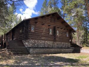 Located on two lots at the historic Lost Creek Ranch, this 1,500 sq.ft. cabin originally built in 1989 is ready to be restored. The heavily wooded parcels borders thousands of acres of Bridger-Teton National Forest. Few locations in Jackson Hole offer this level of solitude and recreational opportunities. Approximately 30 minutes from the famed Jackson Town Square, the Lost Creek Ranch is one of the last remaining private in-holdings in Grand Teton National Park.