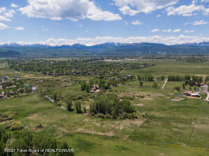Just 2.5 miles south of Town lies 14.42 sunny acres in the Big Trails Subdivision.  Rare horse property available for the horse enthusiast.  No horses? Build the perfect toy barn to take advantage of all that Teton County has to offer. There are sweeping mountain views to fill every window of your dream home.  Live water and small clusters of trees add character to this ideal Jackson Ranchette. Bring your architect and builder to plan out the perfect Jackson homebase.