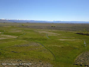 Own a half section of land right outside Pinedale.  Incredible views of both the Wind River and Wyoming mountain ranges.  Opportunities abound here.  Build your dream home and have lots of room for your kids & horses to run and roam, or subdivide it into (9) 35 acre agricultural parcels which are much needed in this area.  The lower irrigated acreage has wonderful meadows and puts up 50 tons of hay without any fertilization. The upper acreage is great for calving, homesite(s) or development.  It is part of the Highland Irrigation District and is allotted and assessed for 316 acres of water.  It also has a 75' water well with submersible pump(with generator) for stock water.See drone footage under ''Videos''