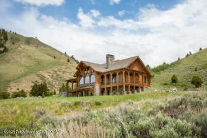 On 4.68 rolling acres, this 5,960 sf 4 br, 4.5 bath residence with 1,296 sf 1 br, 1 ba ARU is a chapter in the Leek family's storied JH history. Set on a knoll overlooking the former S.N. Leek Ranch, the property enjoys a private location with no CCRs, just minutes from the Square. Modern design, detailed engineering and quality materials were thoughtfully orchestrated into a home that is bright, comfortable, immaculately maintained and optimizes the attributes of its setting and views. Details include 10-ft ceilings, Unilux windows and doors, 3/4'' white oak floors, custom cabinetry and solid doors, in-floor heat, Crestron lighting, Nest technology, automatic shades, surround sound, and hi-speed internet. Enjoy a main floor master suite, 2 laundry rooms, a pantry, sauna, wine room and more