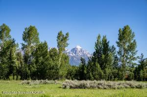 It is rare in Jackson Hole to find a building site landscaped 30 years prior to development. Formally an estate protection lot, this 3.71 acre parcel has a park like setting with full Teton views. The abundance of trees offers full privacy, and  sits only 10 minutes from down town Jackson Hole. The southern end of the property boasts a seasonal stream and backs up to Jackson Hole Golf and Tennis providing further protected southern views.