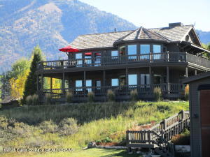 At the Alpine Airpark, this classic 2,528sq foot home sits on the ridge, with certainly the best elevated views of the surrounding mountains, Palisades Reservoir and the 46U runway. This 3 bedroom 3 bathroom home has two gas fireplaces and an open plan living area surrounded by spacious decks on both floors for enjoying the views.  On the grounds is a1,314 sq foot 2 bedroom, 2 bathroom cozy self contained  guest cabin, perfect for family, friends and with a one car garage, the cabin also opens the option for a full time property manager. The 60x60 hangar sits below the house with easy access to the runway and has rustic Wyoming cabinetry for plentiful storage.  The park like setting with mature Aspens, Pines and Birch trees with fire pit for evening star gazing. The property is irrigated and with flower garden to compliment the stairway down to the hangar.  This  two acre property with views that take in the beauty of the Alpine Airpark with hangar, residence  and guest cabin will make a wonderful home for a keen aviator, family and friends.