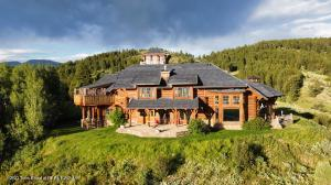 This spectacular setting on 288 acres bordering BTNF with panoramic views of Star Valley features a beautiful 7,320 sq. ft. Log Home, 1,431 sq. ft. private guest house, 1,906 sq. ft. detached garage/barnwith a 902 sq. ft. studio apartment and a 900 sq. ft. detached shop.  Perfect corporate retreat of family compound providing the ultimate Wyoming getaway.