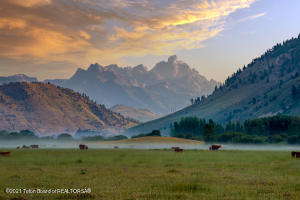 Simply being in Jackson Hole is a dream.  Now imagine owning a historic piece of Jackson Hole.  We call that ''living the dream''.  Arguably one of the most spectacular ranches in the country, this 162+ acre homestead has been family-owned since 1947.  A property this large rarely comes on the market and this offering is a once-in-a-lifetime opportunity. Absorb the benefits of ultimate privacy while enjoying panoramic mountain views including the Grand Teton, the Snake River Range and Munger Mountain.  Located south of Town and considered to be in the ''banana belt'' of Jackson Hole which is important for those of us who want to squeeze out every extra minute of summer.  While private and serene, the drive to the airport and Teton Village is an easy 20 minutes, and Town a short 10 minutes where you can enjoy high-end shopping, restaurants, and world-class entertainment at the Center for the Arts.  The property is also near an exclusive polo field, two private golf courses and accessible to the path system that connects to Grand Teton National Park and the Jackson Hole Mountain Resort.    Imagine drinking your morning coffee while watching the ethereal fog lift from the valley floor, exposing the local elk herd and giving way to magnificent light spreading across the Grand Teton.  Design your legacy estate and take advantage of the ability to subdivide into four, 40-acre parcels with 12,000 sqft of development per parcel, or keep it all for yourself.  Create the lifestyle you have always dreamed of in Jackson Hole.