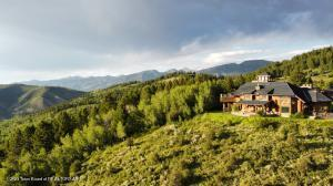 Bordering the Bridger Teton National Forest, this 243 acres of forested land with expansive views, features a 7320 sq. ft. Log Home, 1431 sq. ft. guest home, and a detached garage with caretakers quarters.  Great corporate retreat of family compound.
