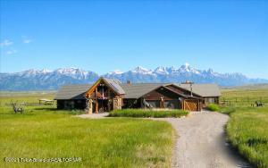 Set on 5.14 acres bordering the National Elk Refuge with unobstructed view of the Grand and the Teton Mountain range, this property is a rare opportunity to enjoy a rural atmosphere just 10 minutes from downtown Jackson.  The almost 4,000 square foot home offers 3 bedrooms and 3 bathrooms.  A bonus room and a loft provide additional space for sleeping, an office, gym or other needs.  The exceptional views and spacious setting make this horse-friendly property unique.  Highlights include vaulted ceilings, tall windows to welcome the magnificent views, a spacious primary suite, and a 3-stall attached garage.  Enjoy a pastoral atmosphere with easy access to the National Forest and where the wildlife viewing opportunities are among the absolute best in the Jackson Hole Valley.