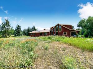 This unique log construction property is conveniently located on Moose-Wilson rd, across from the Teton Pines Golf Course and The Aspens. The property consists of a 3624 sq. ft. main house and 1106 sq. ft. guest house with oversized garage for a total of 2.28 acres with beautiful Teton views. The main home contains 6 bedrooms and 2 bonus rooms. There is country kitchen, large dining room and cozy living room on the main level and master bedroom and the spacious loft on the 2nd level. The guest house is 2 bedroom, 2 baths and is 1106 sq. ft. No CCR's and no HOA. Surrounded by mature trees, property has beautiful gardens and lots of outdoor entertaining areas.
