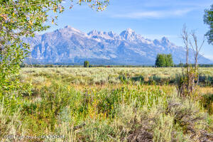 Incomparable building lot in one of the most exclusive neighborhoods in Jackson Hole. This 17.71-acre lot is located in Bar-B-Bar Meadows and features captivating and expansive Teton views. The property is bordered to the north by 52.82 acres of view-protection lots and to the south by more than 25 acres of Teton County Scenic Preserve Trust easements. As one of the largest lots in Bar-B-Bar, this property offers a serene and private building site. This is the first time this property has been available for sale publicly in more than 20 years.